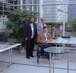 Участники международного конгресса IСCEES в г. Тампере, август 2000 г. (стоят слева направо: П.В. Дружинин и А.И. Шишкин из Института экономики, за столом: Д. Зимин и Х. Ескелинен из Университета Йоэнсуу)